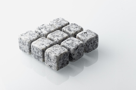 Set of nine spirit chilling stones. Soapstone rocks are carved in cubes to be used as drink chiller (whisky, bourbon ...) Various type of raw minerals produces different colors, such as marbled grey.