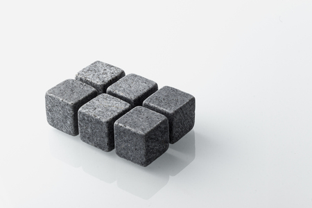 Set of six spirit chilling stones. Soapstone rocks are carved in cubes to be used as drink chiller (whisky, bourbon ...) Various type of raw minerals produces different colors, such as dark grey.
