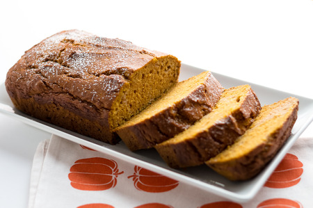 Slices of pumpkin bread. Pumpkin bread is a thick sweet cake loaf made with pumpkins. Typically baked in Fall season, it is the perfect halloween food as you can use Jack OLantern carving leftovers!