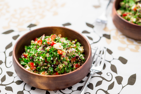Greek style tabbouleh salad. This healthy dish mixes tabbouleh & greek style salads, using fresh parsley herb, olives, onions, feta and replacing the bulgur usually found in tabouleh with quinoa.