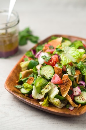 Fattoush salad vertical view. The key ingredient in this middle eastern dish is the toasted pita bread which is mixed with healthy vegetables, herbs and a dressing made with lemon and sumac. Stock fotó