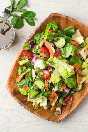 Healthy fattoush salad from above. The key ingredient in this middle eastern dish is the toasted pita bread which is mixed with healthy vegetables, herbs and a dressing made with lemon and sumac. Stock fotó