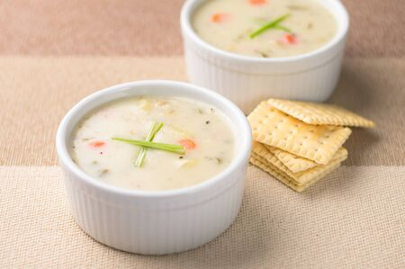 Warm bowls of clam chowder. Traditionally from the United States, New England Clam Chowder is a delicious type of hearty and creamy soup. It commonly made with clams, potatoes, onions and celery.