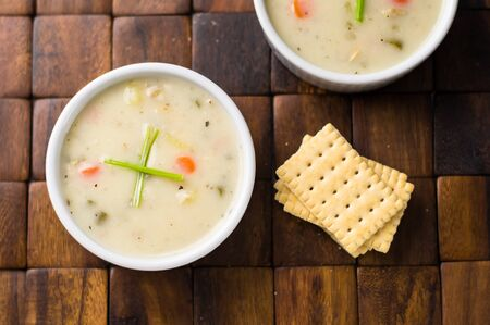 Clam chowder from above. Traditionally from the United States, New England Clam Chowder is a delicious type of hearty and creamy soup. It commonly made with clams, potatoes, onions and celery.