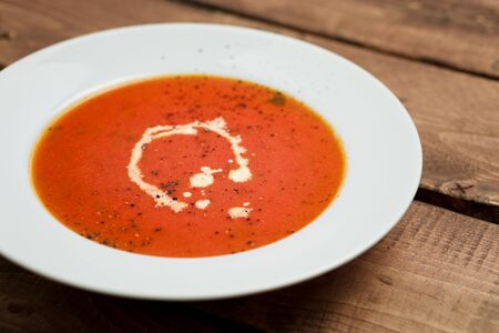 Creamy tomato soup. A classic comfort food, tomato soup is often enjoyed near summer end or fall. It is a simple and healthy soup using ripe tomatoes, broth and cream sometimes added.