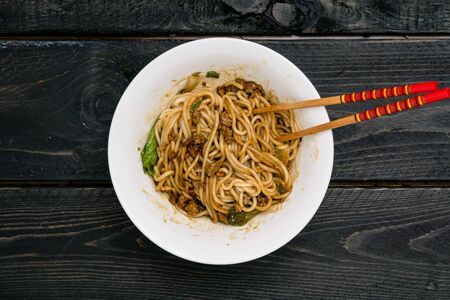 Dan Dan Chinese Noodles. Dan Dan Noodles is a spicy Szechuan cuisine dish commonly found in chinese street food. Ingredients include thick rice noodles, sichuan pepper, chili oil and ground pork.