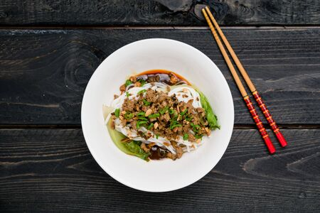Dan Dan Noodles from above. Dan Dan Noodles is a spicy Szechuan cuisine dish commonly found in chinese street food. Ingredients include thick rice noodles, sichuan pepper, chili oil and ground pork. Stok Fotoğraf