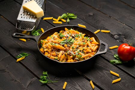 Penne one pot pasta dinner. This quick & delicious pasta meal is made with penne pasta, fresh tomato sauce and sausage. This italian inspired comfort food is cooked and served in a cast iron skillet.