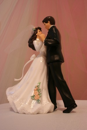topper: Bride and groom dancing with a pink background