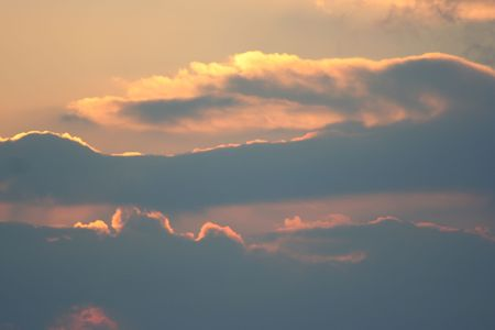 puffy: Bright clouds during sunset