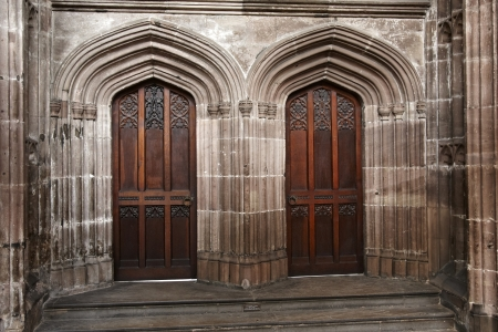 lintels: Pair of doors in Manchester Cathedral taken from inside the building Stock Photo