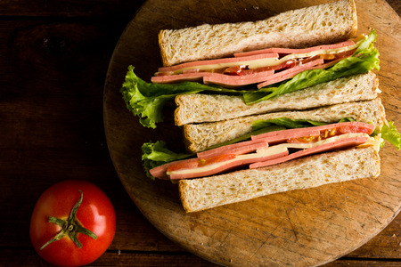 ham cheese: Sandwich ham cheese, whole grain bread, organic salad, cheese, fresh tamato and ham Foto de archivo