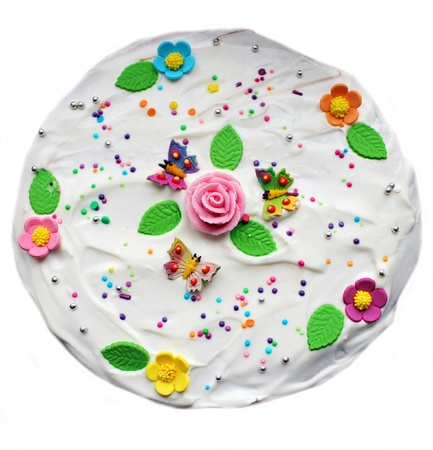Tasty cake decorated with flower and butterfly