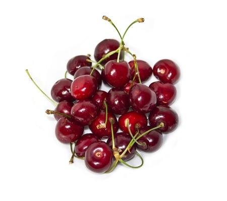 Fresh cherries isolated on white