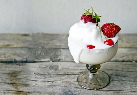 Ice cream with cherry and strawberry photo