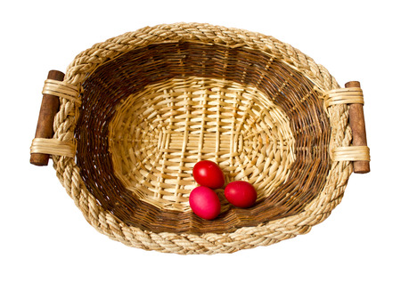 Three red eggs in a basket for the easter