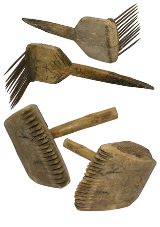Old wool comb and mallet retro objects