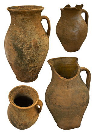 A collection of historic handmade earthenware isolated on white Stock Photo