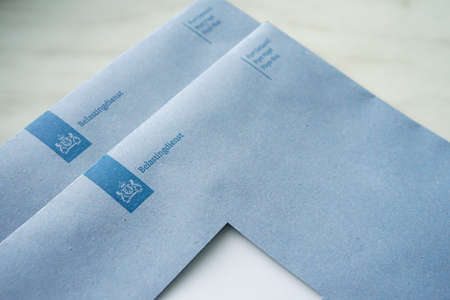 Official blue envelopes of the Dutch Tax Authorities (Dutch: Belastingdienst)