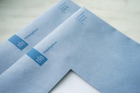Official blue envelopes of the Dutch Tax Authorities (Dutch: Belastingdienst)