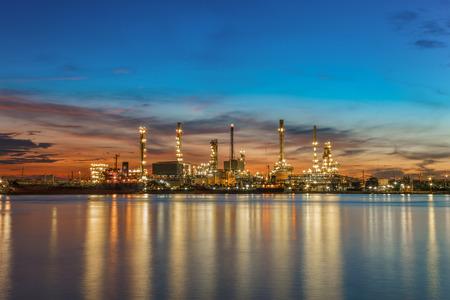 refine: Oil refinery along the river at Dusk (Bangkok, Thailand)
