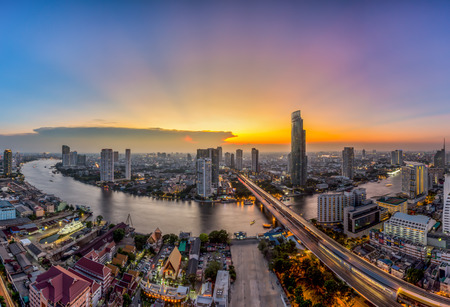 scenery: Bangkok Transportation at Dusk with Modern Business Building along the river Thailand