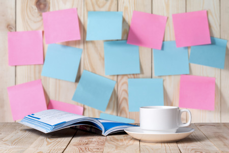 erudition: Coffee mugs to books Background Note Stock Photo