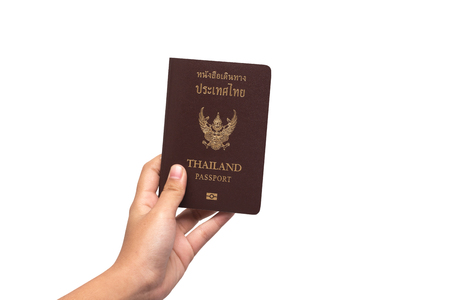 citizenship: Female hand holding a passport white background. Stock Photo