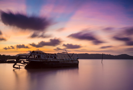 beached: Fishing boat beached with sunset view Stock Photo