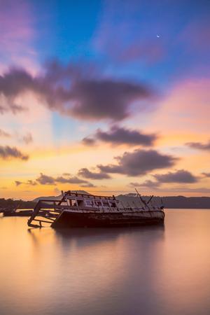 thaiThe ship capsized sunrise Phuket thailand Stock Photo