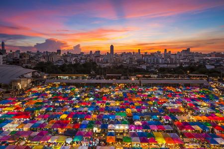 lighten: BANGKOK - JANUARY 23, 2015: View from above of a night market in Huay Khwang district, Bangkok. Editorial