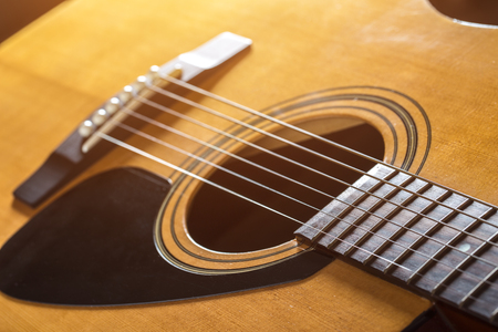 abstract music background: Acoustic guitar with a very shallow depth.