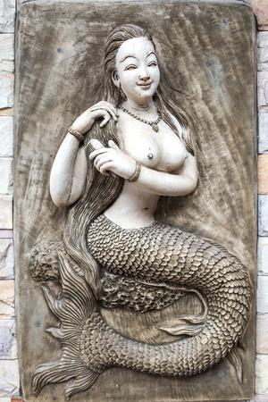 mermaid: Mermaid statue carved plaster