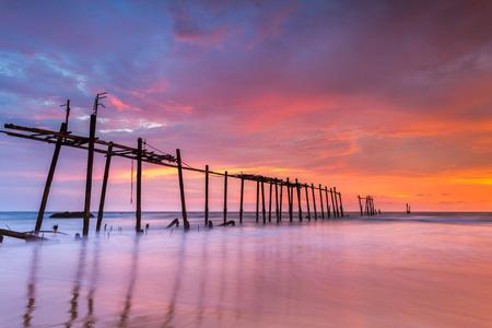 phangnga: Broken wood bridge and waves crashing on sea at during sunset, Phangnga, Thailand