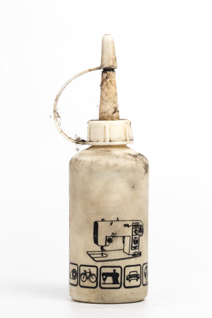 anoint: Old sewing machine oil bottle Stock Photo
