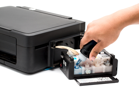 refilling: Refilling the ink printer. Stock Photo