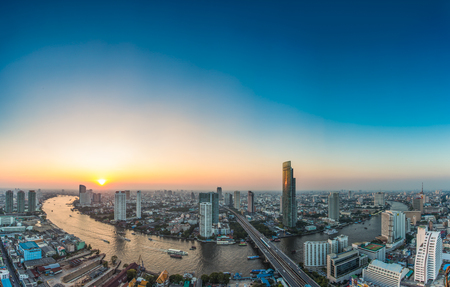 infrastructure buildings: Bangkok Transportation at Dusk with Modern Business Building along the river (Thailand)
