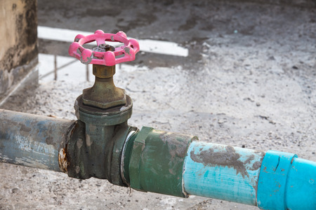 culvert: Water valve connects to PVC pipe. Stock Photo
