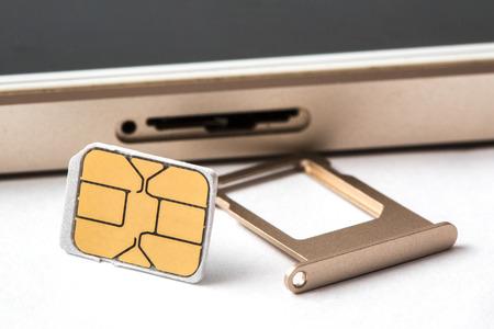 telecom: closeup Nano SIM card ready to insert to smart phone