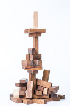 instability: Wooden blocks on a white background