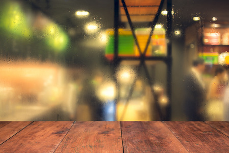 myst: blurred silhouettes of sitting people in coffee cafe Stock Photo