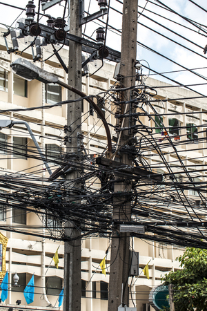 disarrangement: Tangled Electrical Wire on Electricity Post, Disarrangement Concept Stock Photo