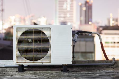 condenser: Air conditioners condenser units at building rooftop