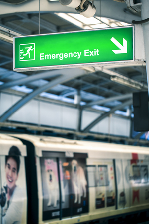 fire exit: Fire exit signs in train stations.