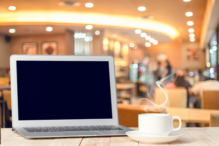 notebook computer: Notebook with a coffee cup.