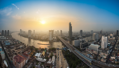 plano: Bangkok Transportation at Dusk with Modern Business Building along the river (Thailand)