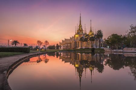 ratchasima: Thai temple named Wat Sorapong near the pond against blue sky in Nakhon Ratchasima or Korat, Thailand
