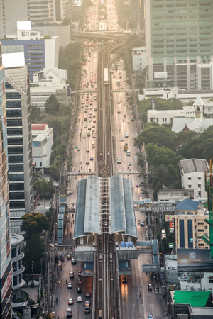 silom: BANGKOK, THAILAND - JULY 6, 2014: A BTS Skytrain arrives at Siam station, an interchange station for BTS Sukhumvit line and Silom line. Editorial