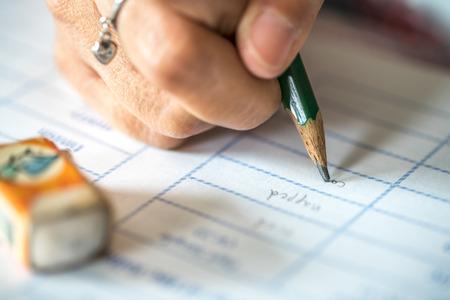 shorthand: Female hand writing, close up