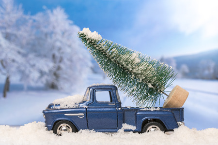christmas toy: Christmas tree on toy car. Christmas holiday celebration concept
